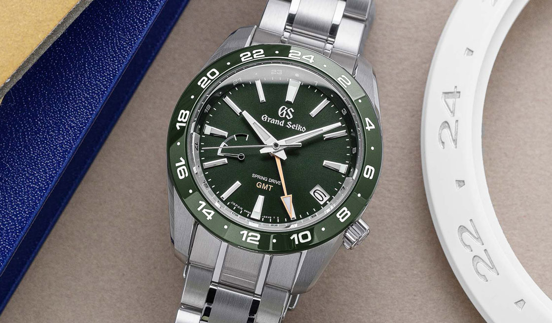 Grand Seiko SBGE257 green dial sport watch with golden accents.
