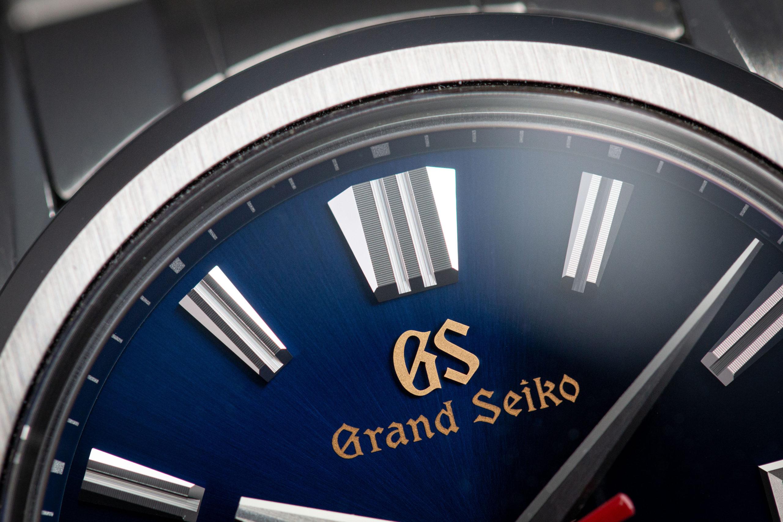 Macro detail of blue dial Grand Seiko SLGH003 wristwatch.