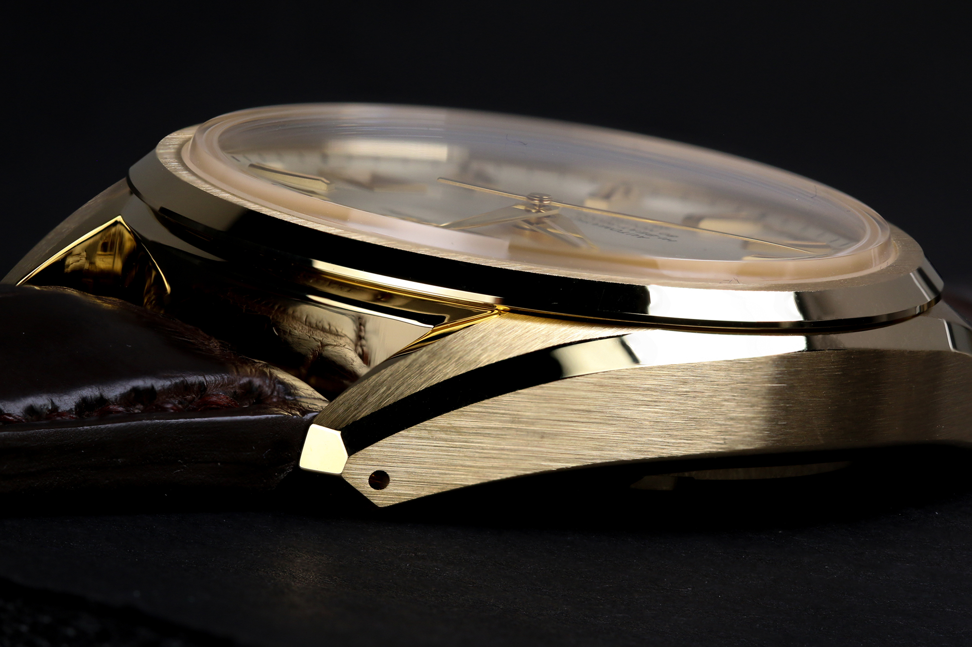 Grand Seiko SLGH002 gold case in profile.