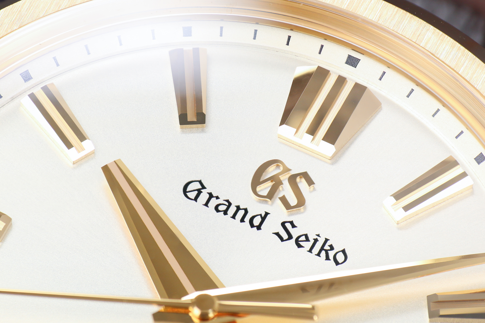 Grand Seiko SLGH002 with a gold case and light dial macro detail.