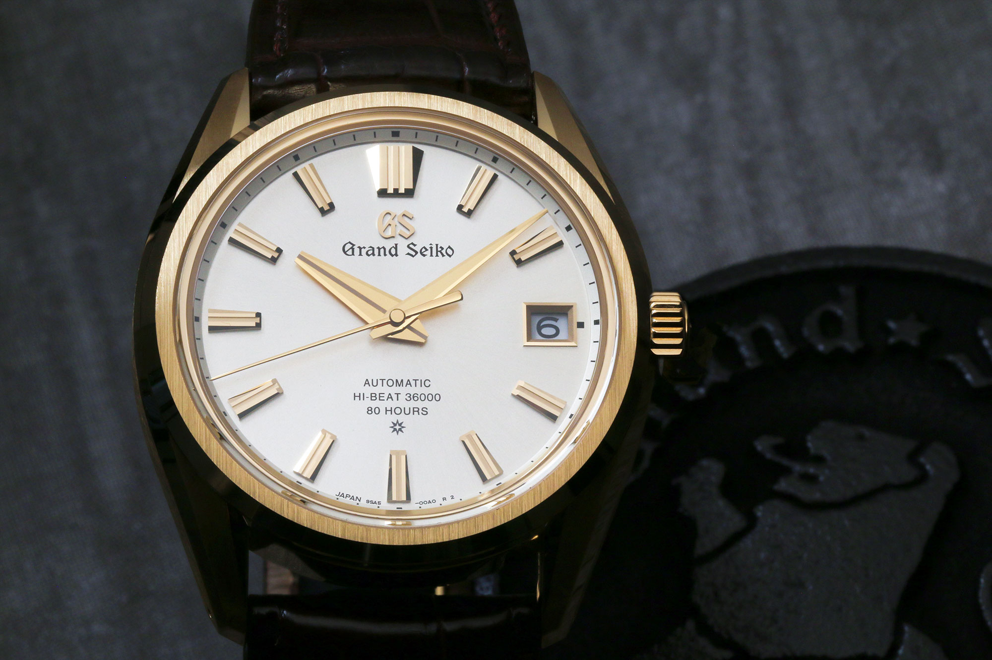 Grand Seiko SLGH002 with a gold case and light dial.