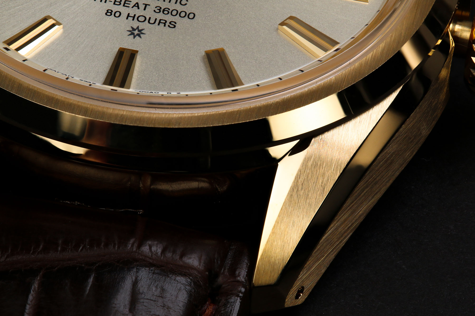Intricate gold case finishing on Grand Seiko SLGH002.