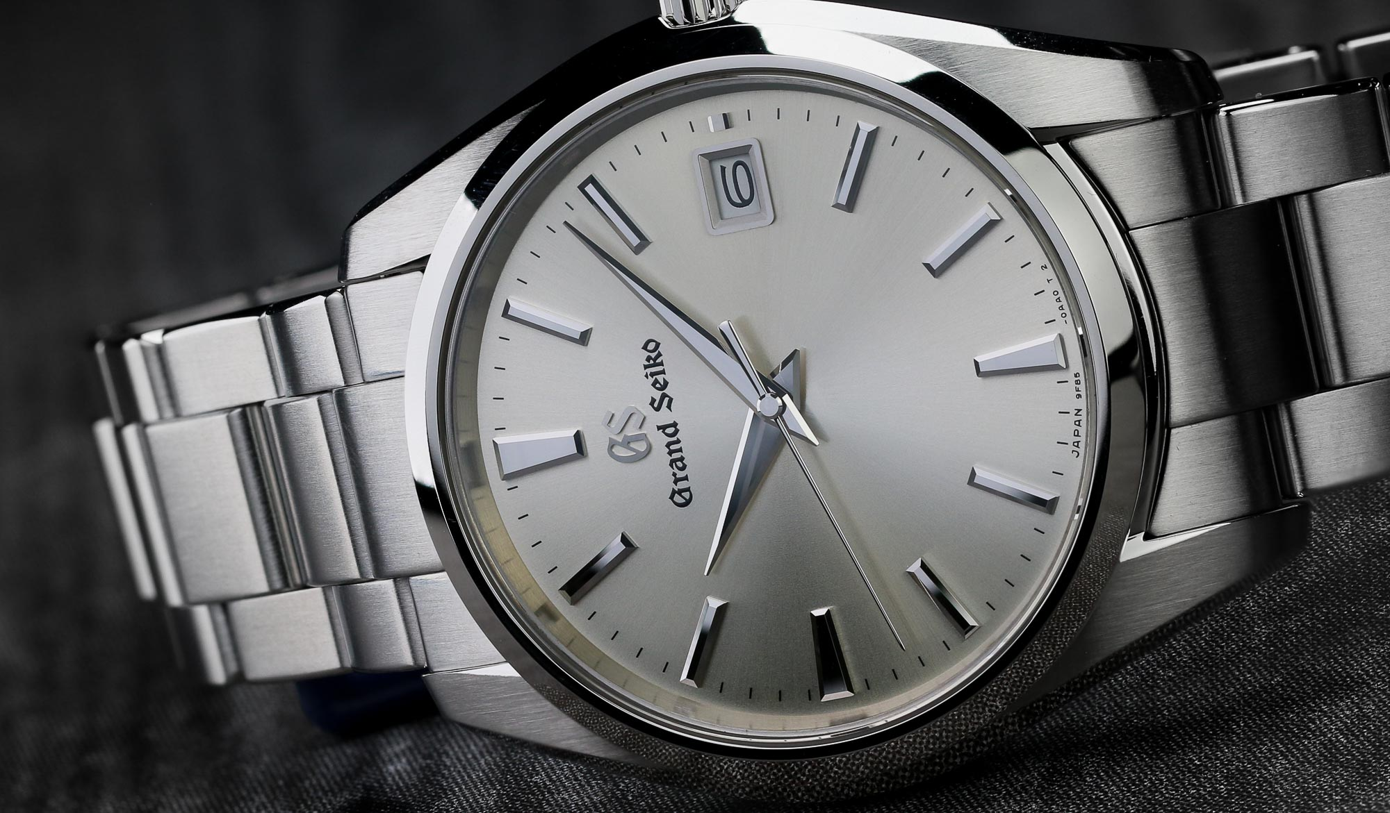 Closeup of the dial of Grand Seiko SBGP009 stainless steel wristwatch with silver dial.