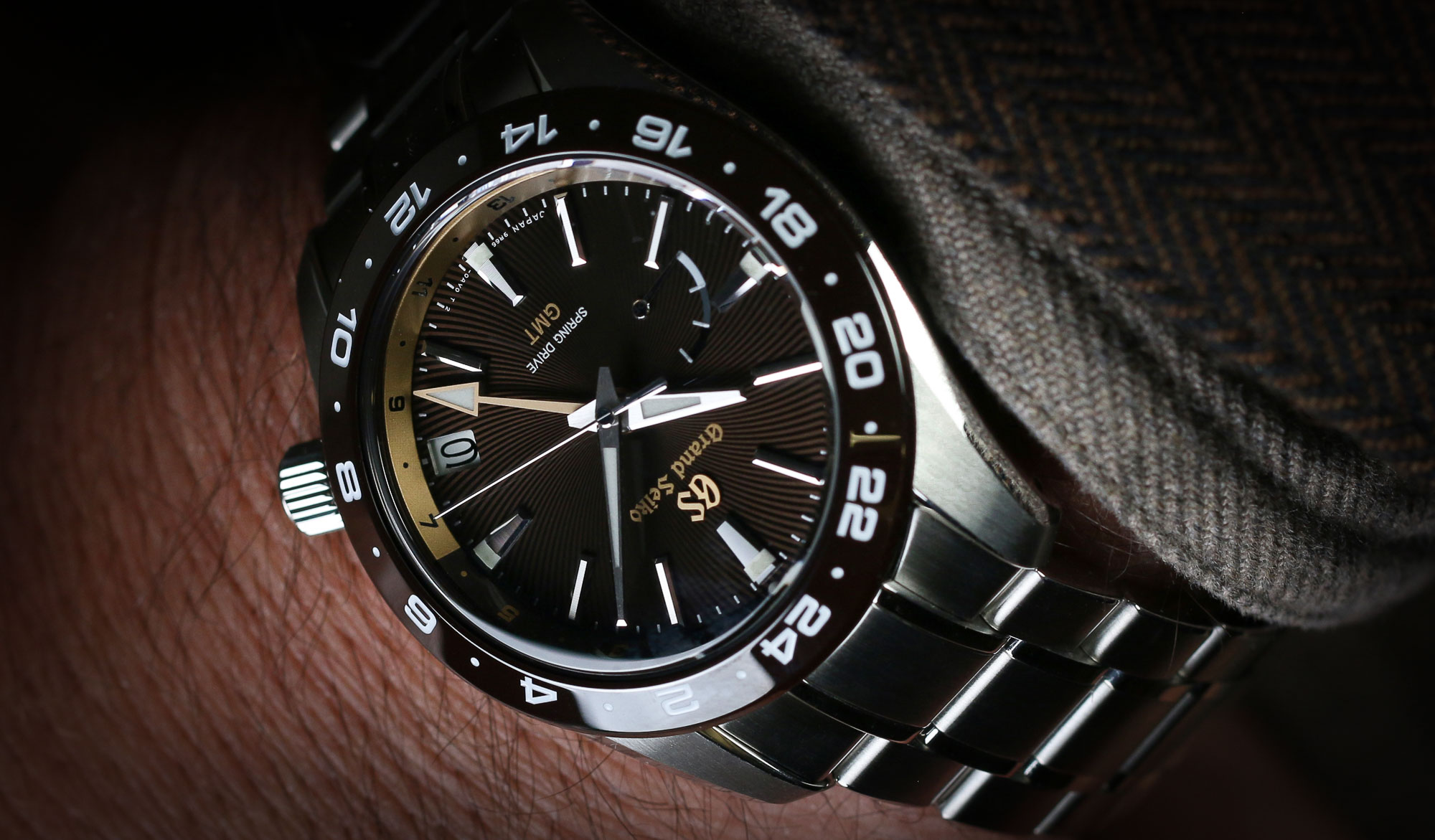 Grand Seiko SBGE263, a brown-dialed wristwatch in the wrist.
