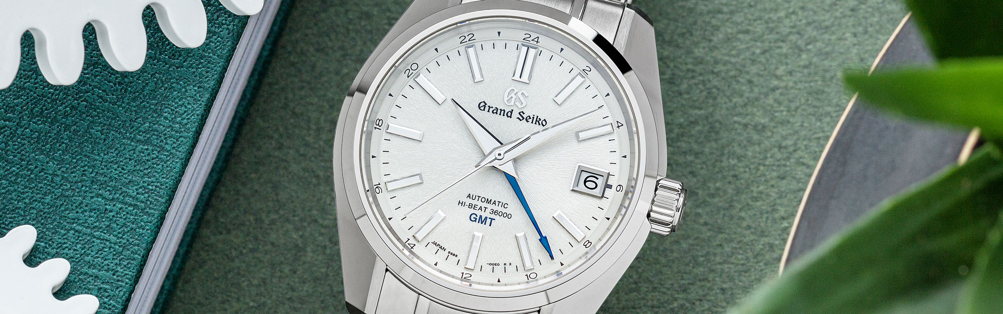 Grand Seiko SBGJ201 white dial stainless steel sport watch with GMT.