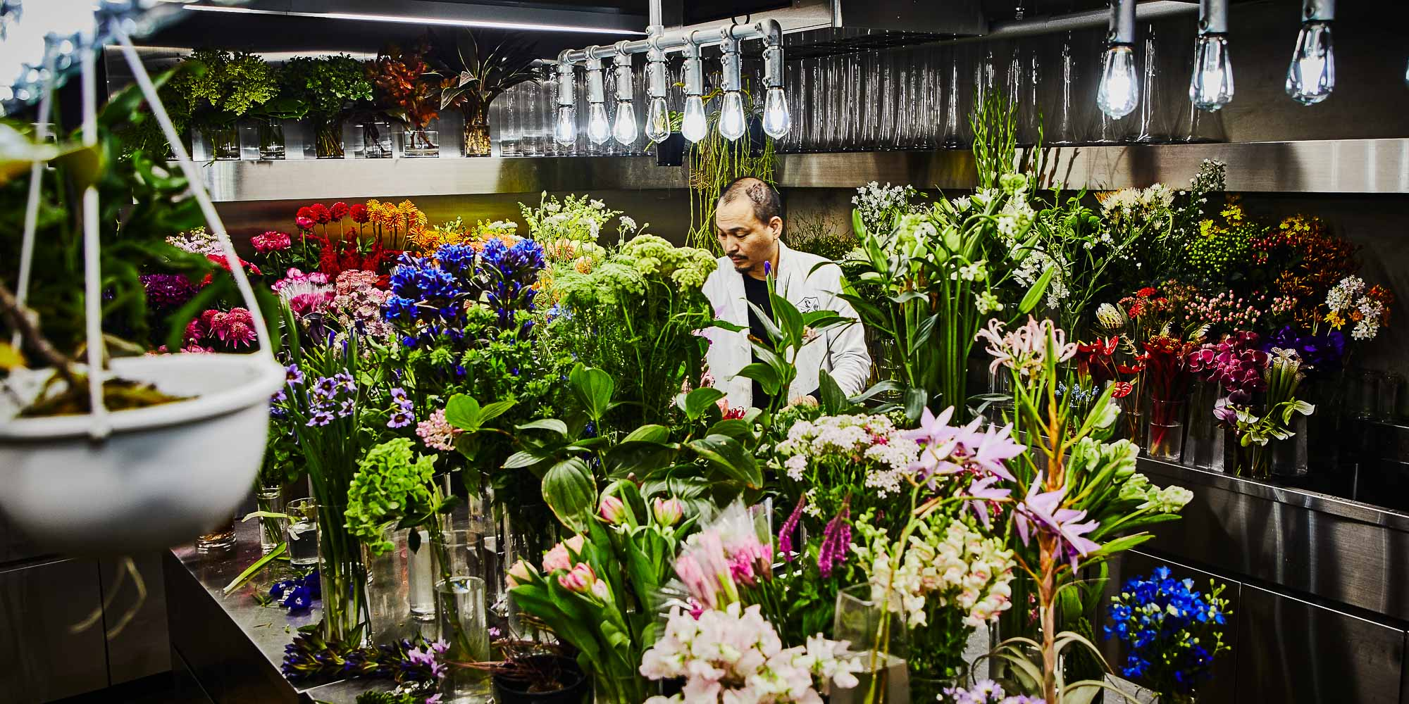 Makoto Azuma floral artist working in his workshop