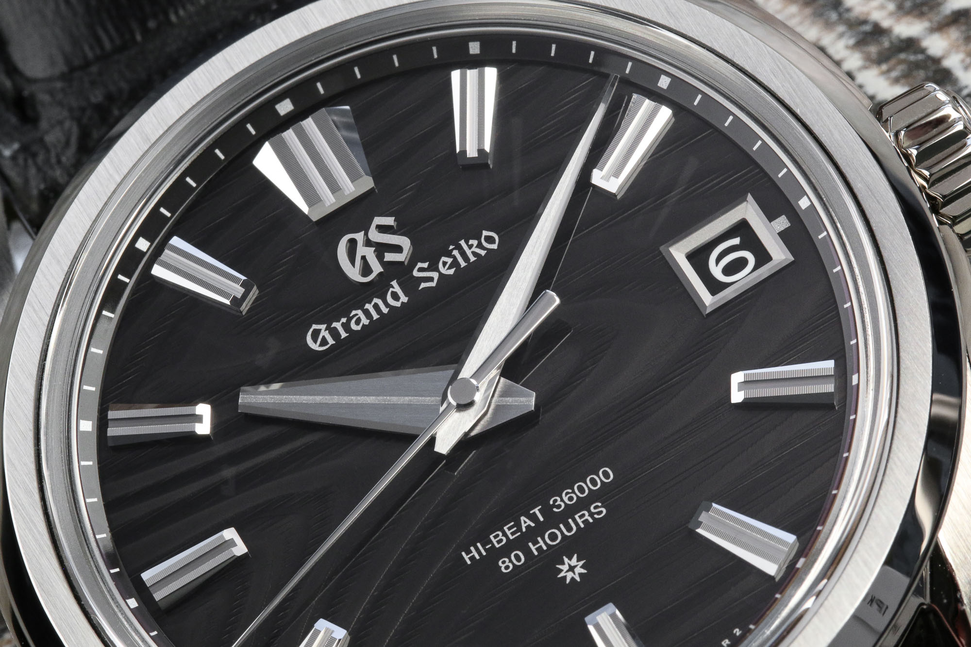 Grand Seiko SLGH007 dark dial stainless steel wristwatch.