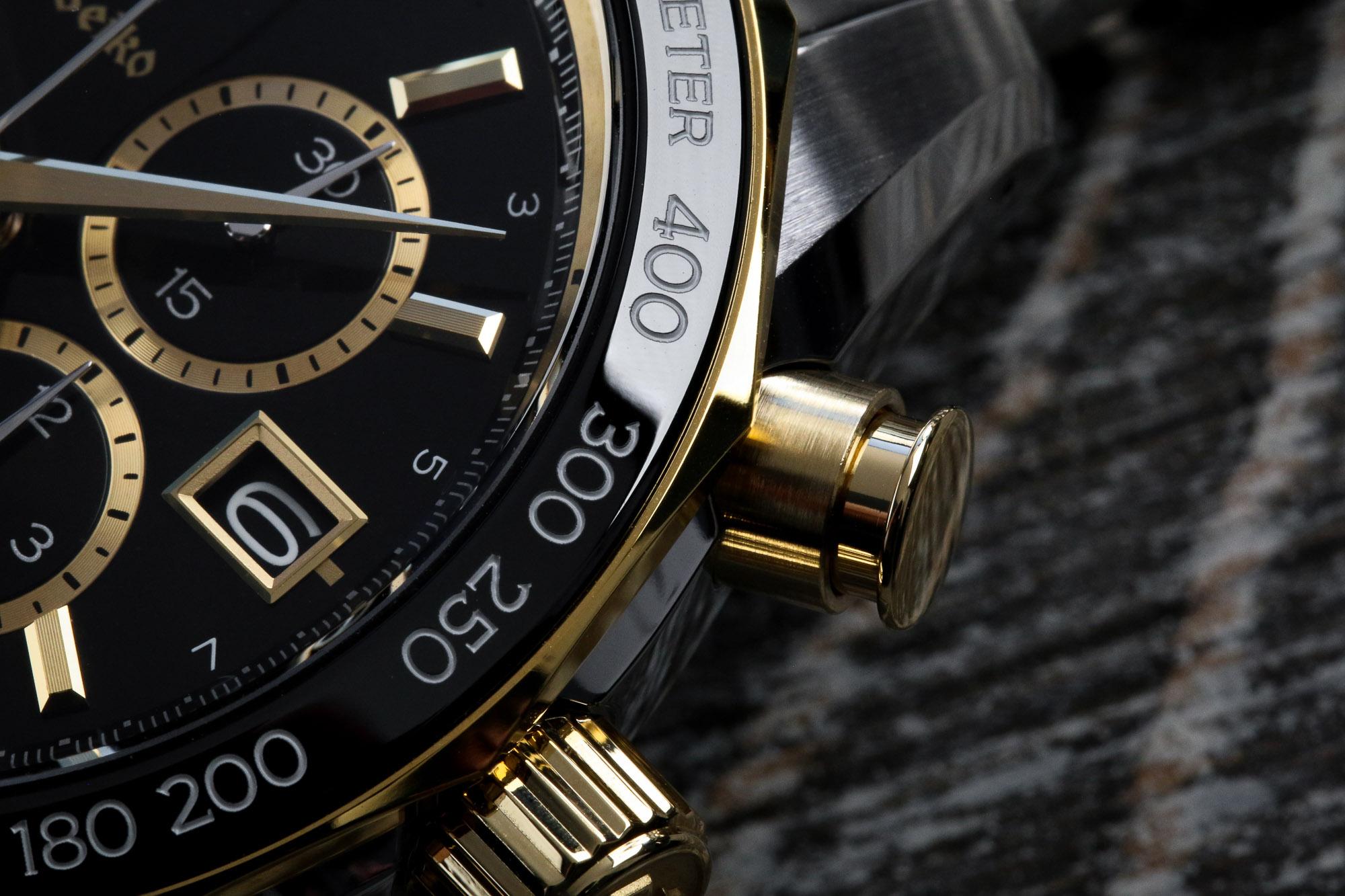 Macro detail of chronograph pusher and bezel SBGC240