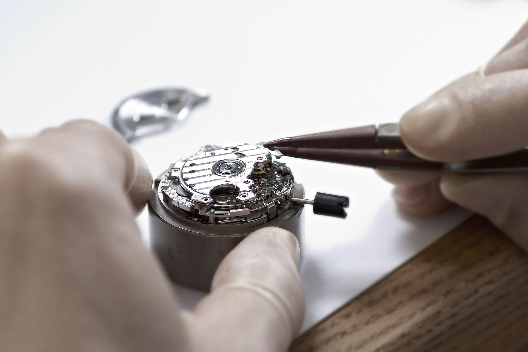 Close up of watchmaker assembling Grand Seiko caliber 9R86.