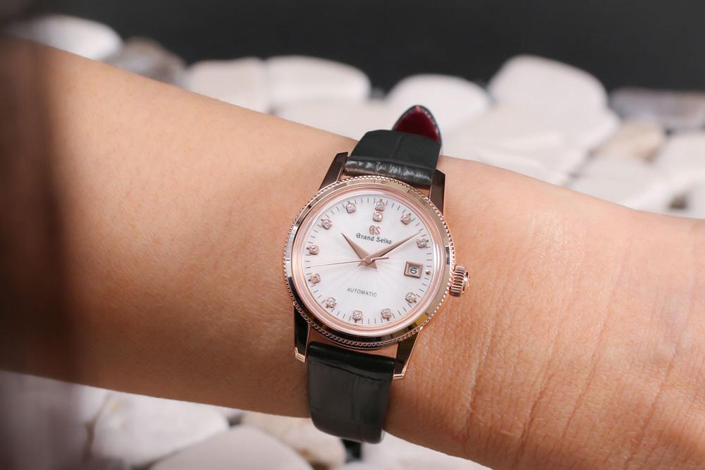 Grand Seiko STGK016 gold ladies' wristwatch on leather strap on wrist