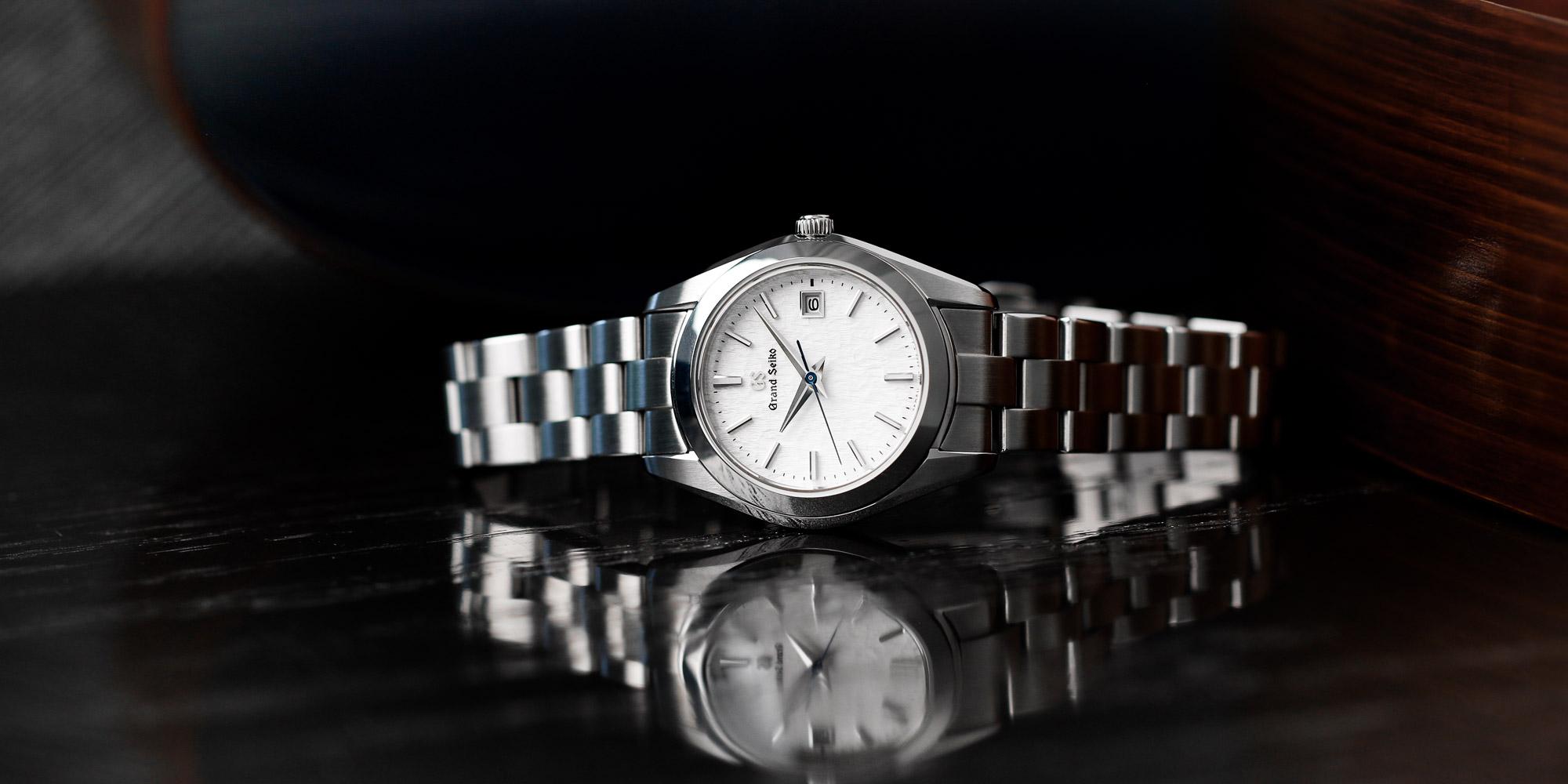 Grand Seiko STGF359 white dial wristwatch on a tabletop