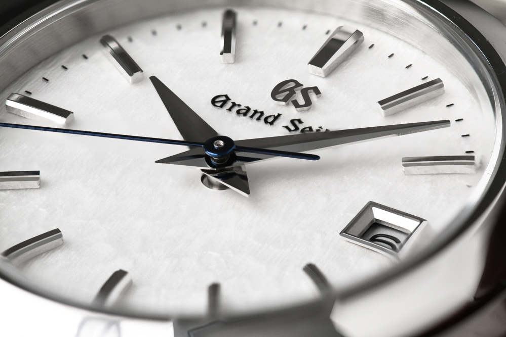 Grand Seiko STGF359 white dial wristwatch dial closeup.