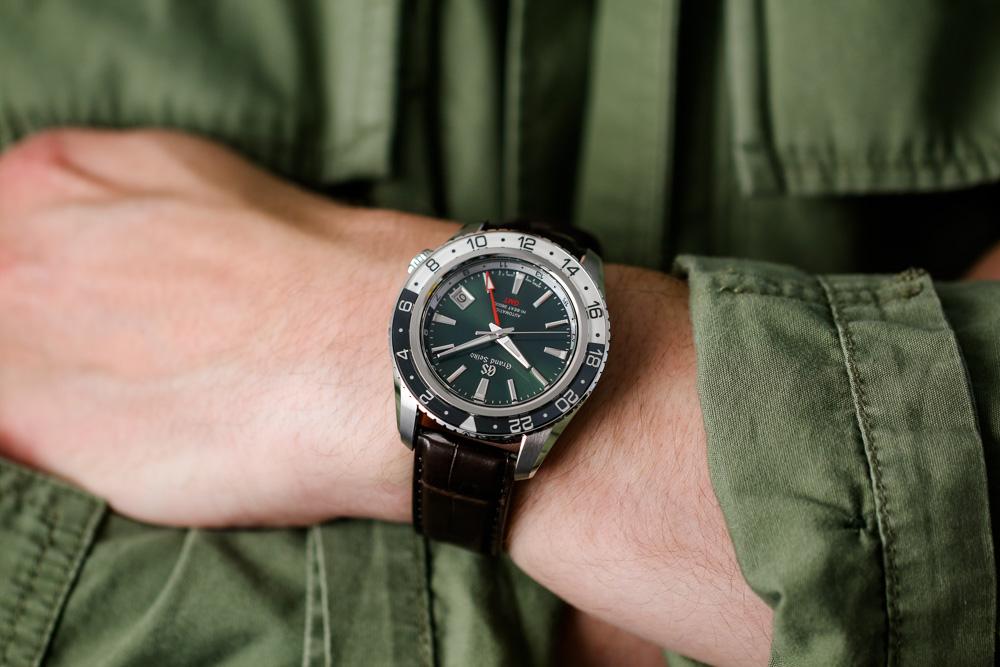 Grand Seiko SBGJ239 Hi-Beat GMT green-dial men's timepiece on wrist