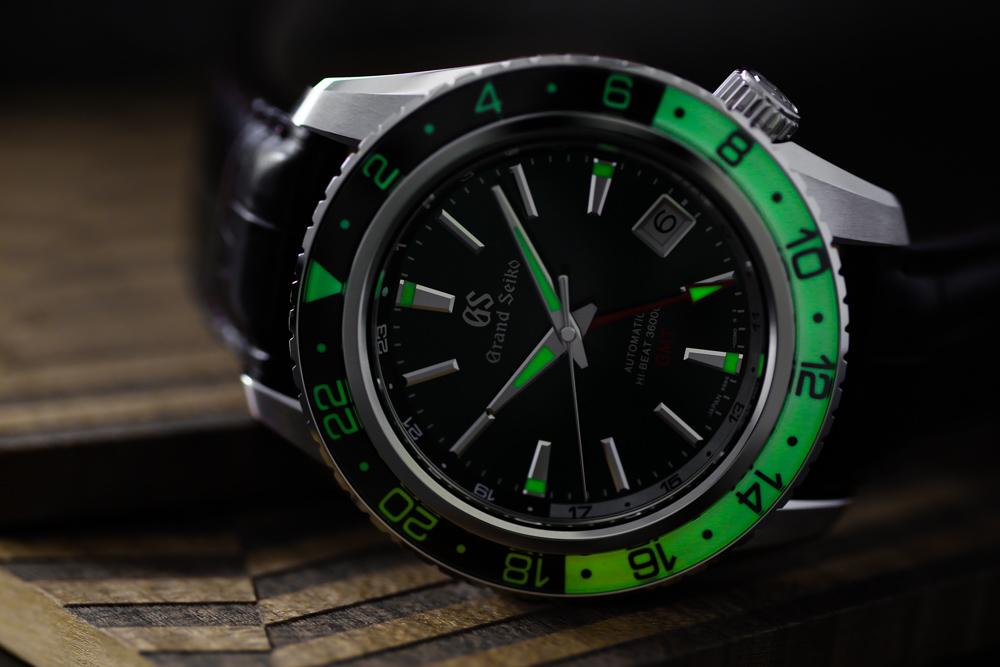Grand Seiko SBGJ239 Hi-Beat GMT green-dial men's wristwatch glowing in the dark