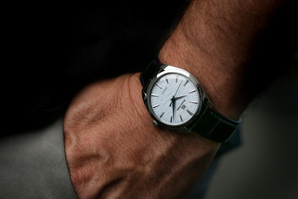Grand Seiko SBGY007 Omiwatari blue dial men's timepiece on the wrist