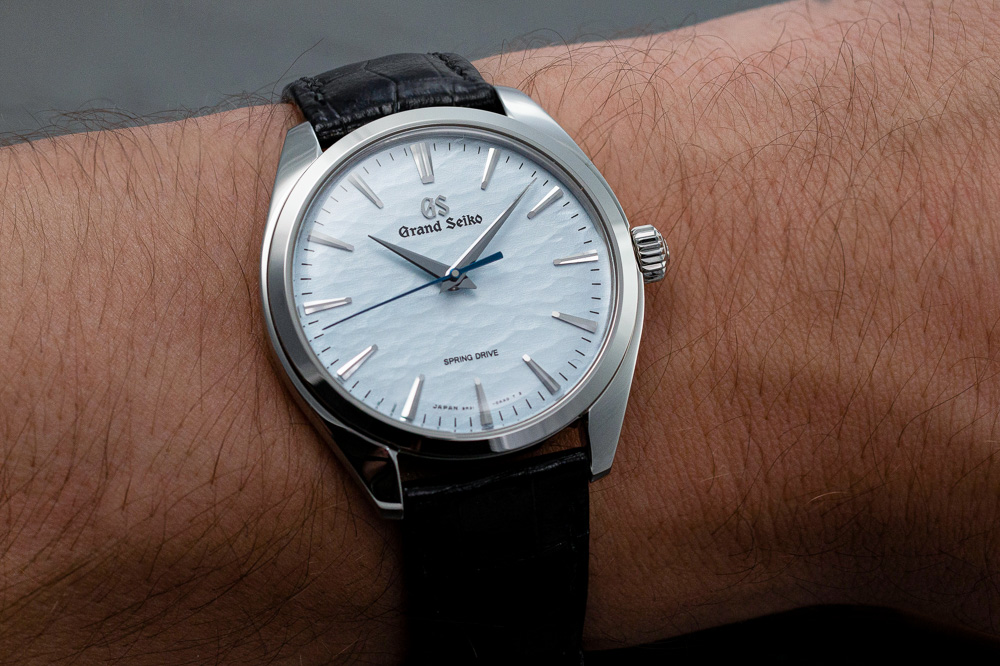 Grand Seiko SBGY007 blue dial men's watch on wrost