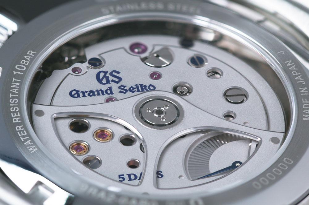 9RA2 movement visible through the exhibition case back of SLGA007.