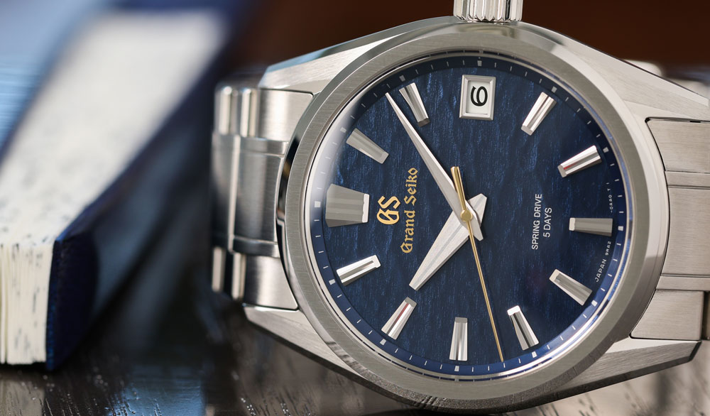 Grand Seiko SLGA007 blue dial watch with Spring Drive movement.