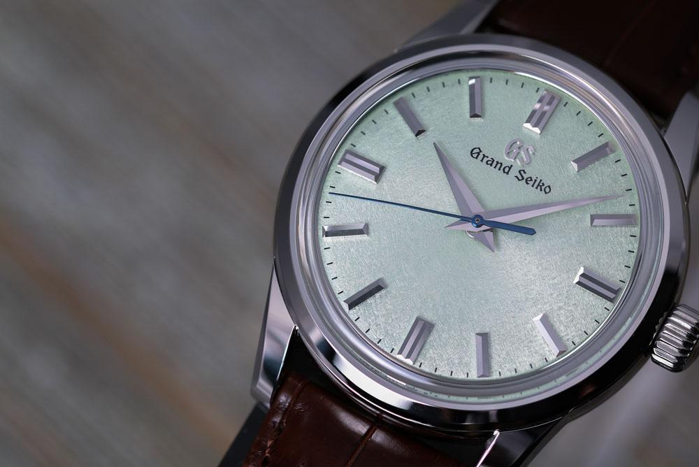 Green dial of Grand Seiko SBGW273 watch.