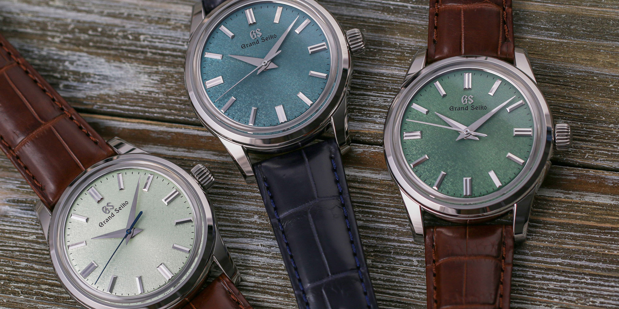 Three green dial watches from Grand Seiko - SBGW273, SBGW275, and SBGW277.