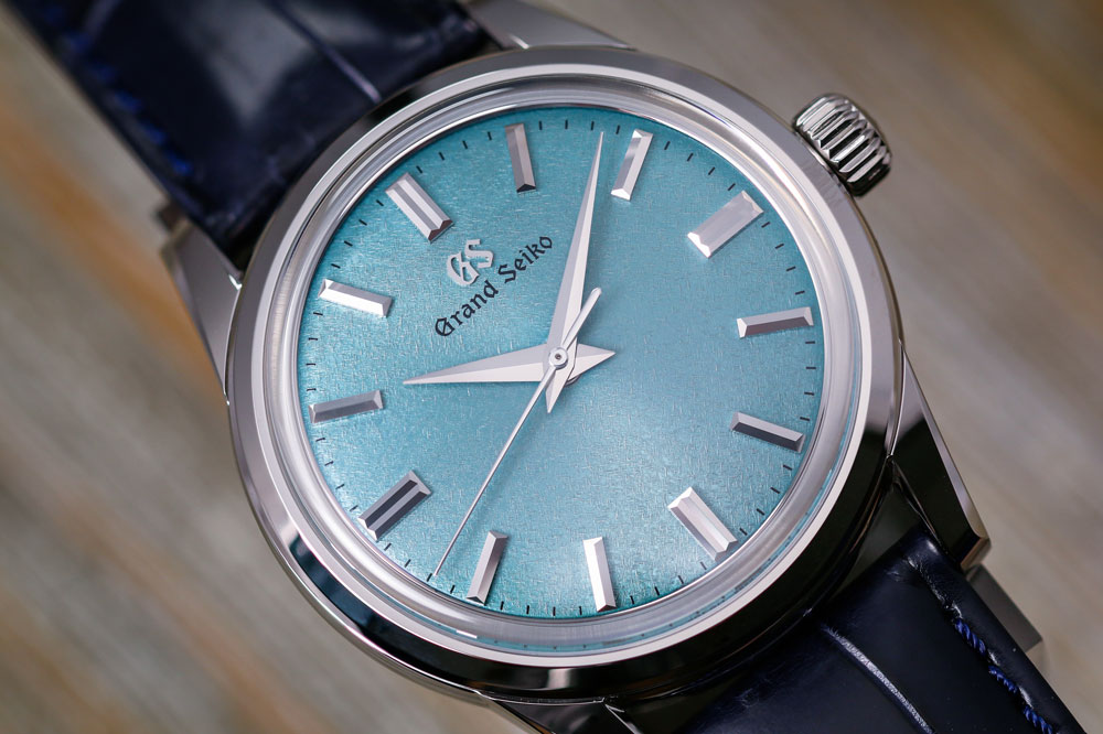 Teal dial of Grand Seiko SBGW275 watch.