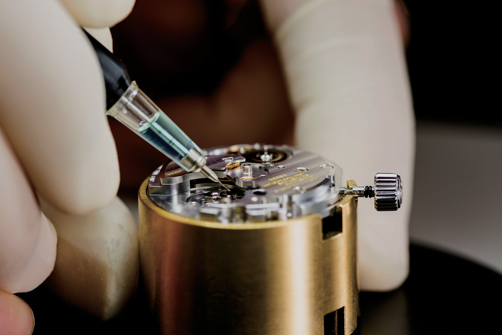 Watchmaker oiling Grand Seiko movement.
