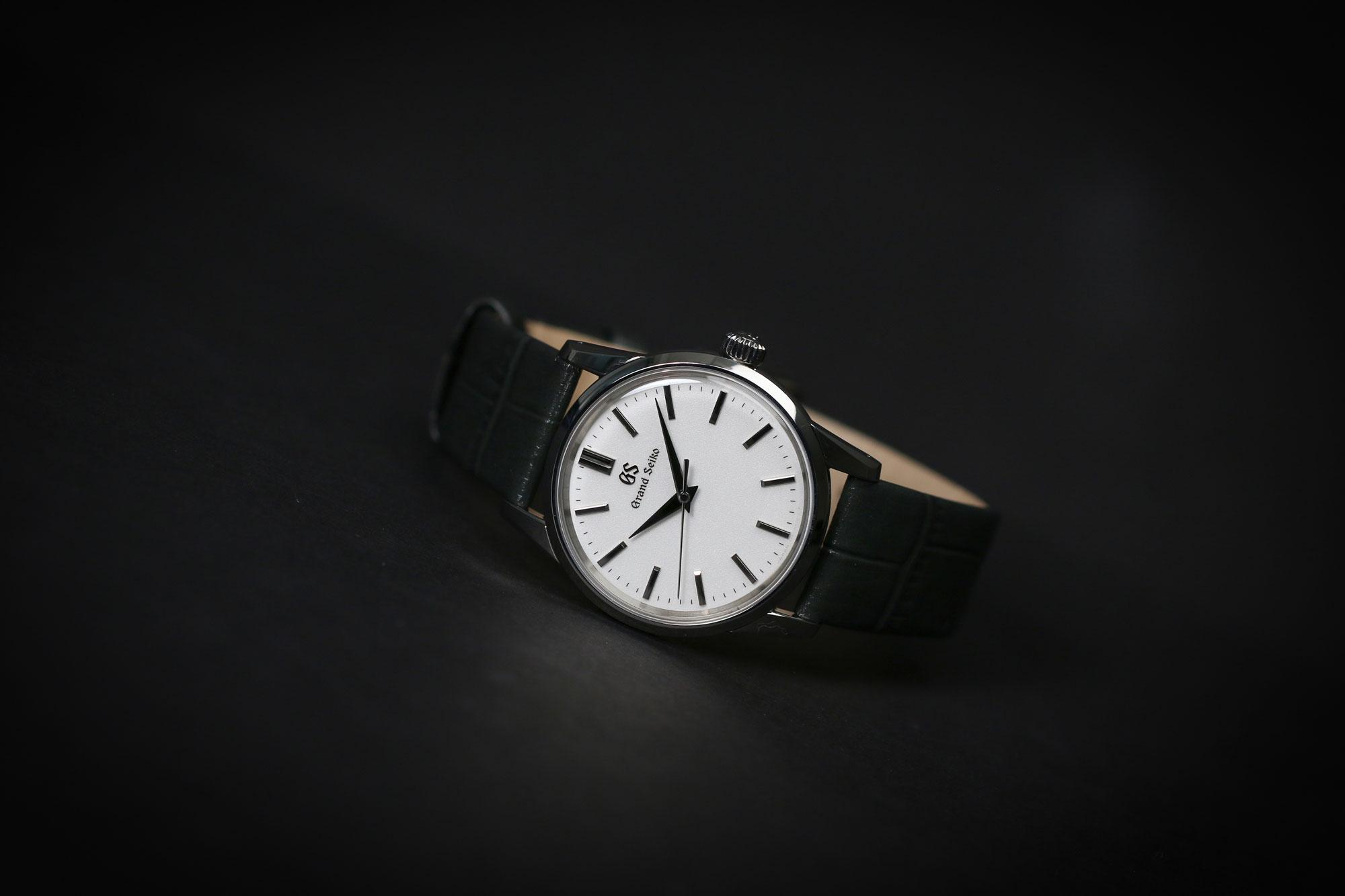Grand Seiko SBGX347 white dial wristwatch for men and women.