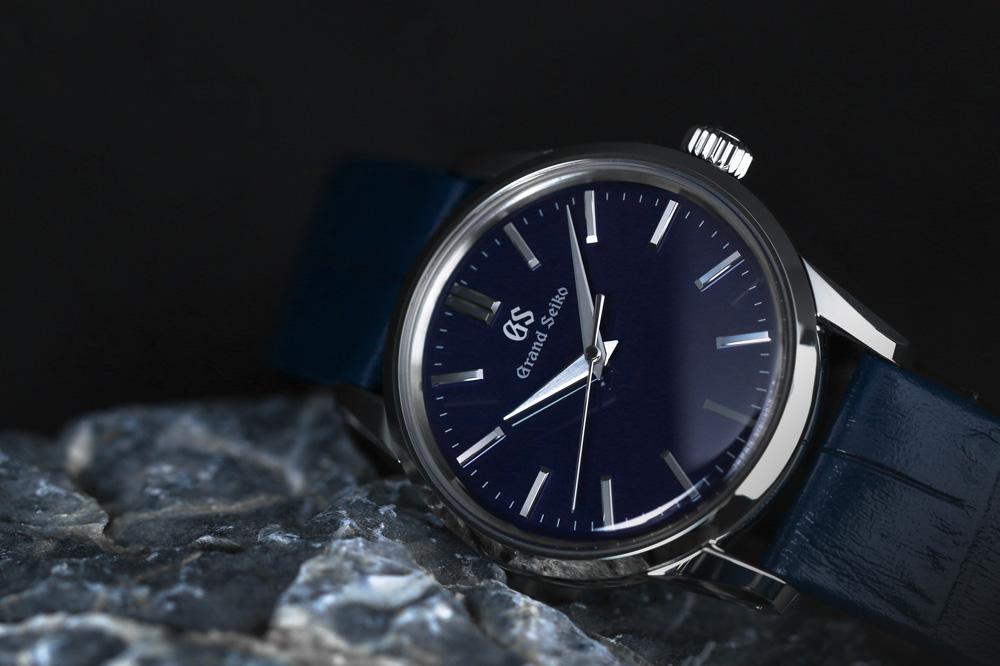 Grand Seiko SBGX349 blue dial wristwatch for men and women.