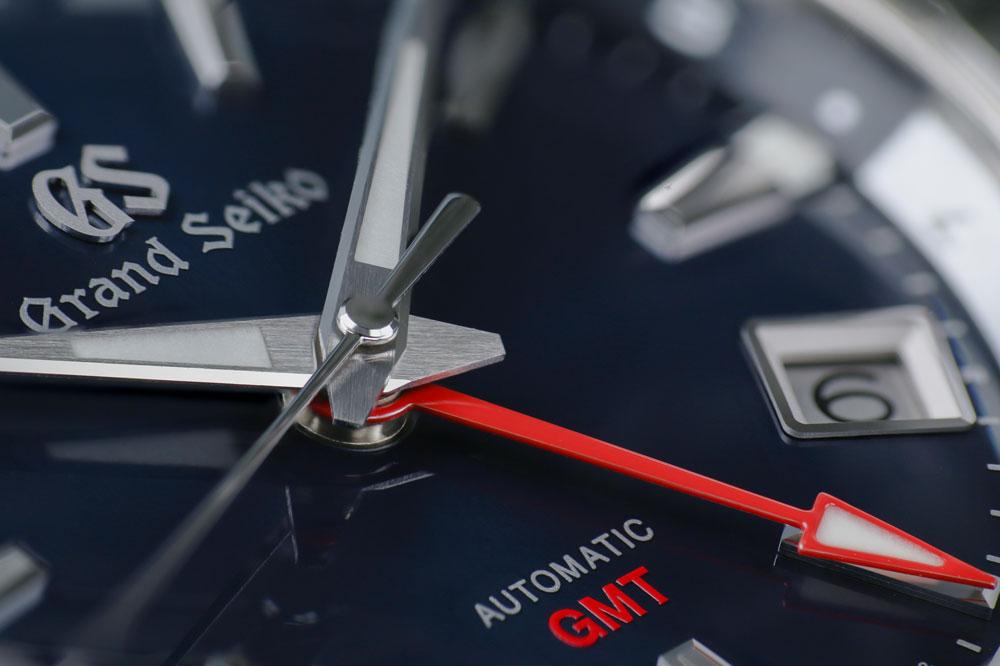 Grand Seiko SBGM245 blue-dialed GMT watch detail