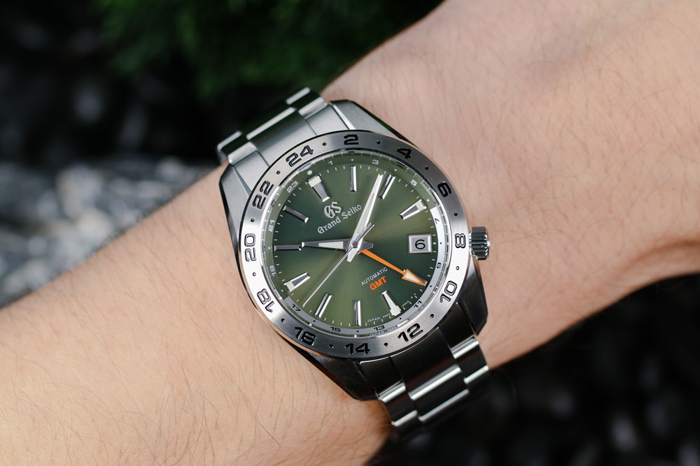 Grand Seiko SBGM247 green-dialed GMT watch on the wrist